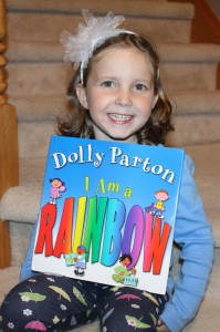 Annaliese accepts her special autographed copy of I am a Rainbow.